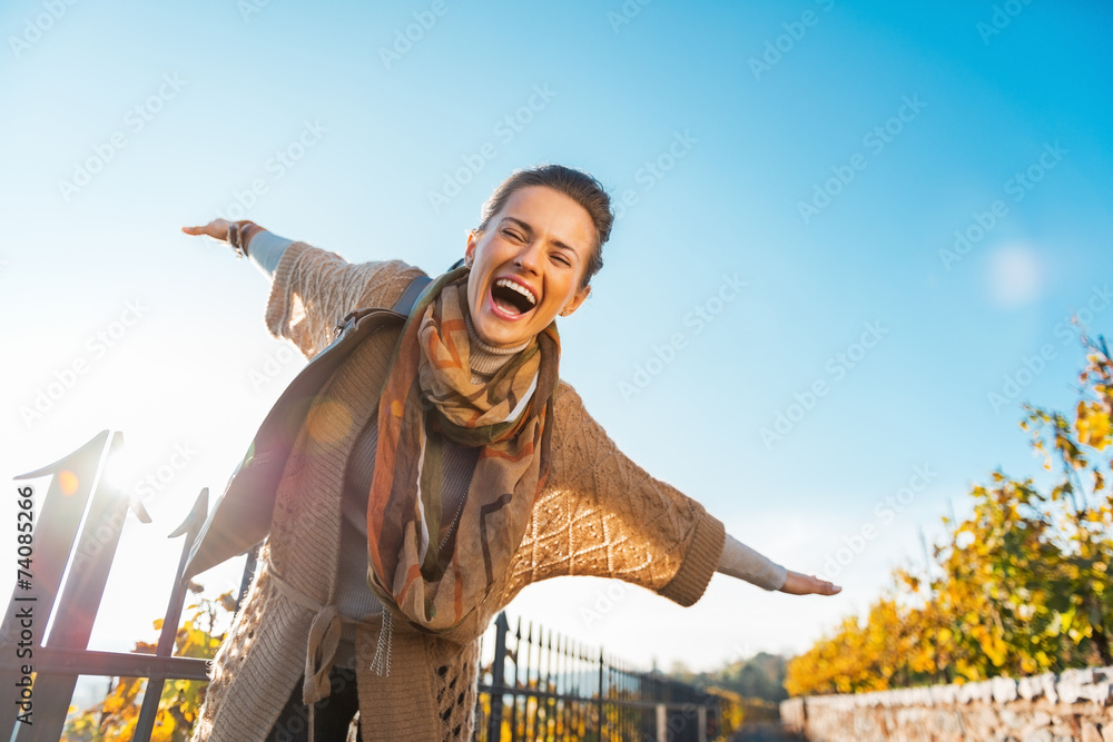 Fototapety, obrazy: Happy young woman having fun time in autumn outdoors
