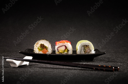Foto op Aluminium Sushi bar Luxurious sushi on black background - japanese cuisine