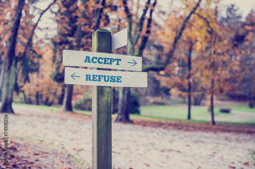 Signboard with two signs saying - Accept - Refuse Canvas Print