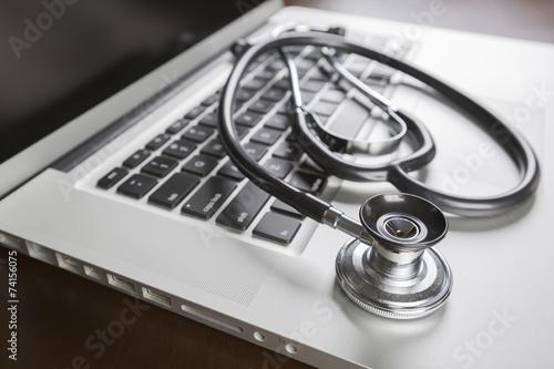 Fotografie, Obraz  Medical Stethoscope Resting on Laptop Computer