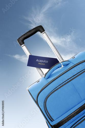 Fotografija  Acapulco, Mexico. Blue suitcase with label