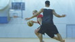 Basketball player attacking and dunking in slow motion