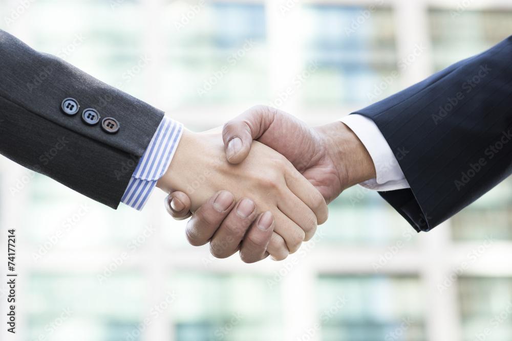 Fototapeta Firm handshake of businessman
