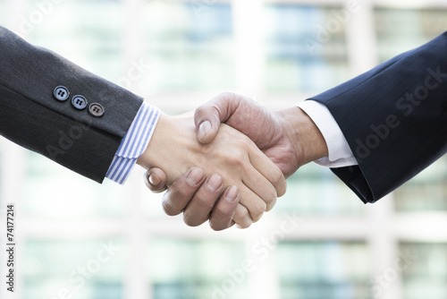 Firm handshake of businessman Poster