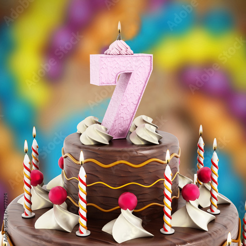 Fotografia  Birthday cake with number 7 lit candle