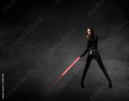 girl in a futuristic military version with laser sword Poster