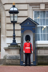 British Royal guards guard the entrance to Buckingham Palace