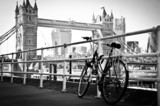 Fototapeta Londyn - Bicycle parked in London in artistic black and white