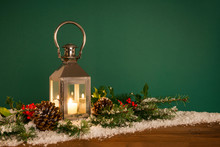 Christmas Lantern Hooly And Snow Green Background