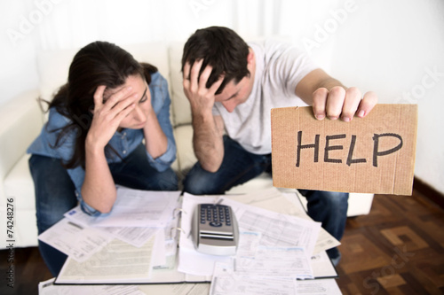 Photo  young couple home bad financial situation stress asking for help