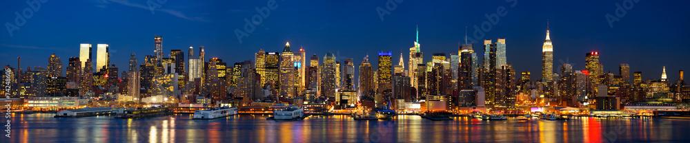 Fototapeta Manhattan skyline panorama at night, New York