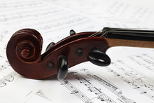 Violin Scroll With Music Sheet Notes
