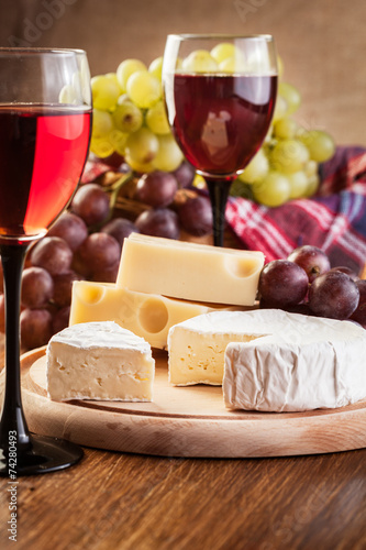 Cheese with a bottle and glasses of red wine Canvas Print