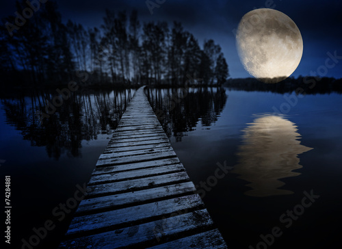 Papiers peints Nuit wooden path on a lake and moon
