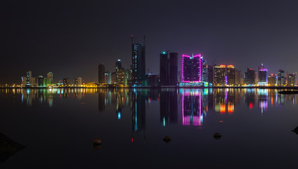 Night modern city skyline panorama with neon lights