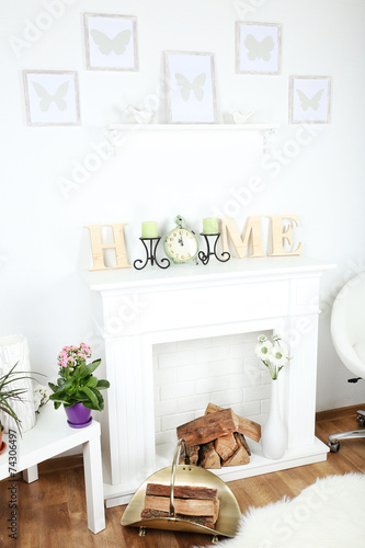 Fototapety, obrazy: Fireplace with beautiful decorations in comfortable living room