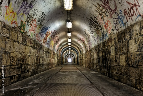 Spoed Foto op Canvas Graffiti Dark undergorund passage with light