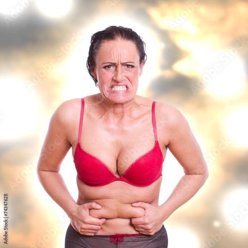 Fotografie, Obraz  Frau frustriert über ihr Bauchfett