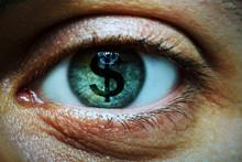 Man With A Dollar Symbol In Hi...