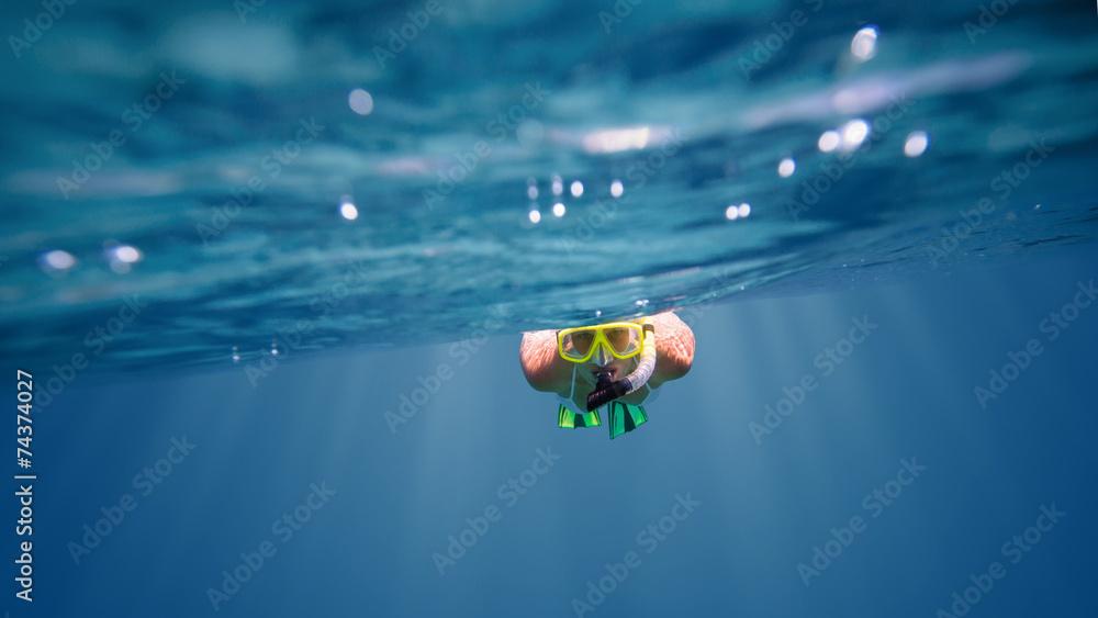 Fototapeta Underwater portrait of a woman snorkeling