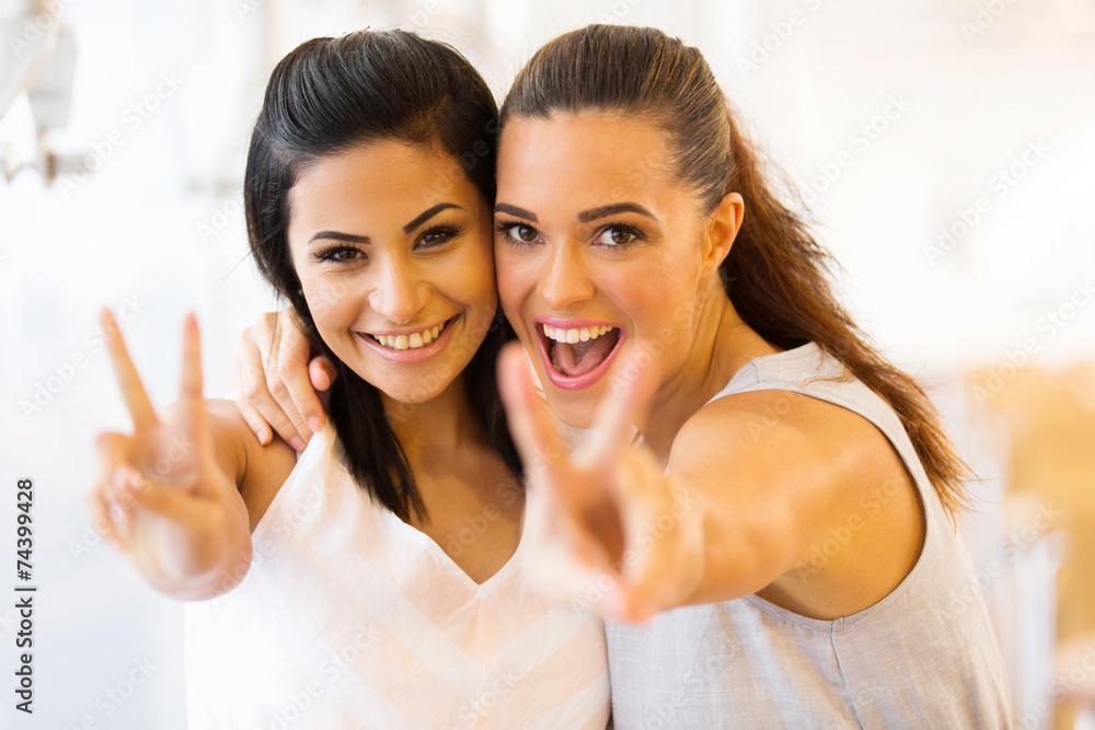 Fototapeta two young friends having fun