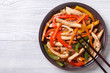 chicken in sweet and sour sauce with vegetables top view