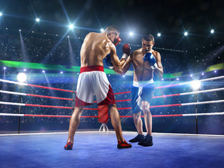 FototapetaTwo professionl boxers are fighting on arena