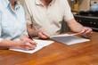 Senior couple reading and writing