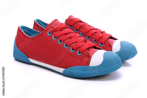 Photo Pair of red sneakers on a white background