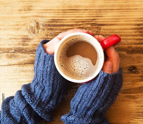 Foto op Plexiglas Chocolade Warm Hands Holding Chocolate Cup
