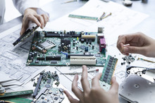 Developers Who Are Assembling A Computer Parts