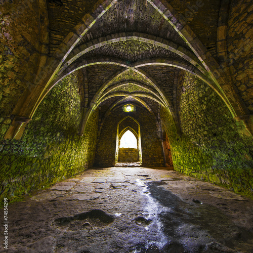 Spoed Fotobehang Kasteel Ancient medieval room with arches