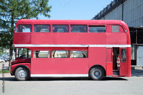 Old double-decker bus at street