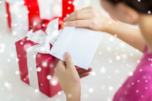 Close Up Of Woman With Letter And Presents