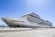 View Of A Huge Cruise Ship Docked In Lisbon, Portugal.