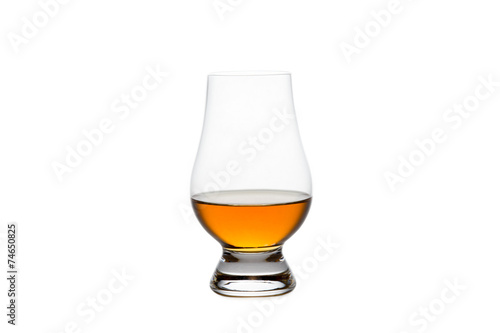 Tuinposter Alcohol Isolated Whiskey in a Crystal Tasting Glass