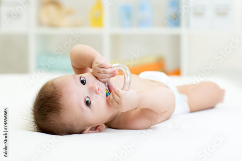 Photo  baby with teether toy