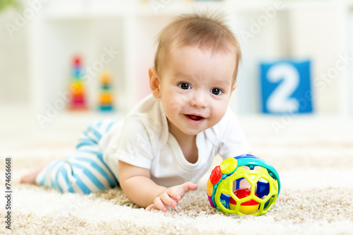 baby boy playing with toys indoor Canvas Print