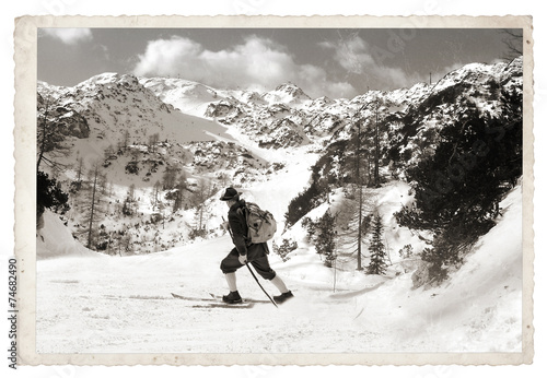 Fotobehang Retro Skier with vintage skis