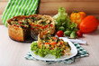 Piece of Vegetable pie with broccoli, peas, tomatoes and cheese