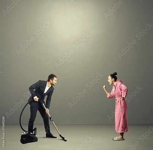 Fotografie, Obraz  man in suit holding vacuum cleaner