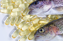 Fish Oil Capsules With Fresh Fish On White Background
