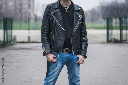 Punk guy posing in the city streets Poster