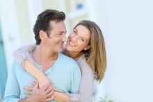 Middle-aged Couple Embracing I...
