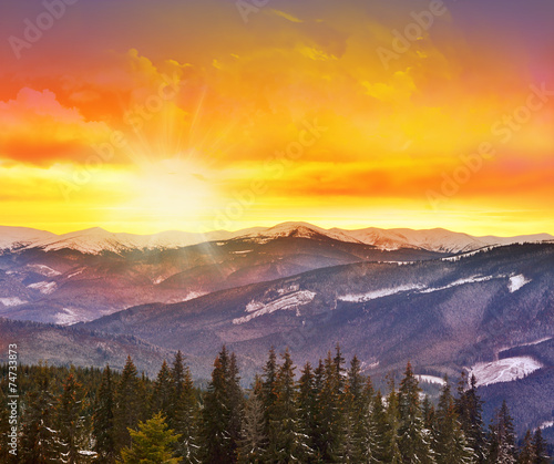 Majestic sunset in the mountains landscape with sunny beams.