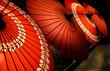 Leinwanddruck Bild - Red parasols
