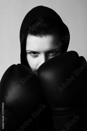 Poster  closeup  portrait of girl with black boxing gloves