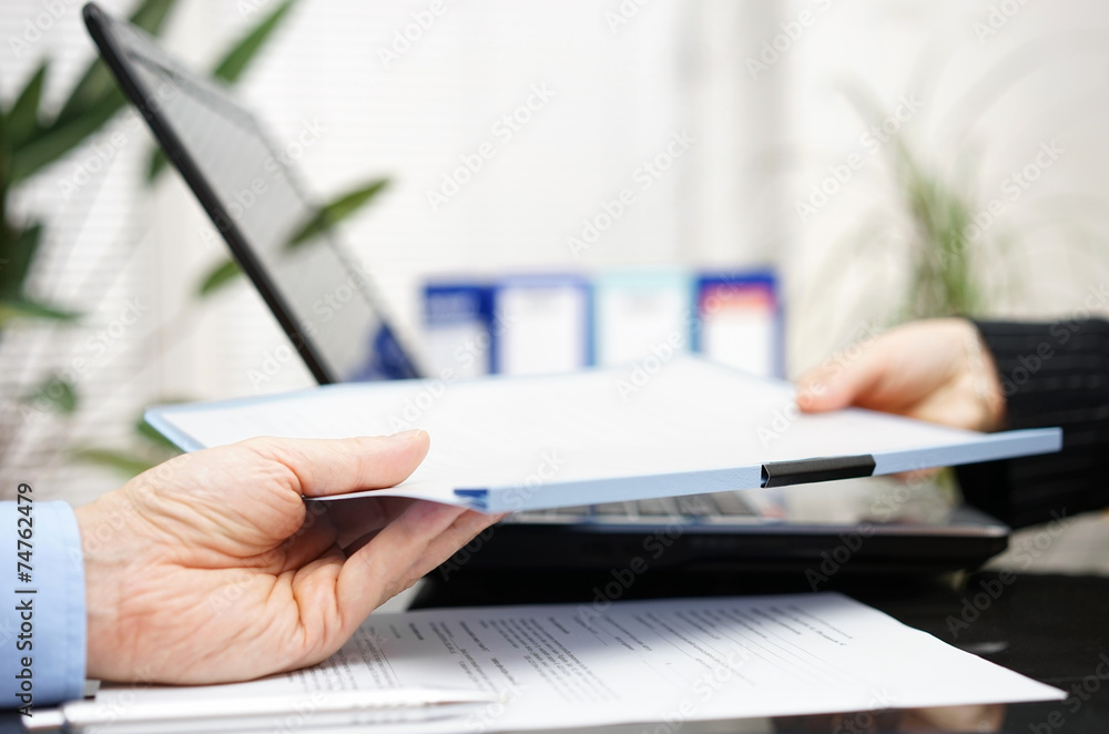 Fototapeta businessman and businesswoman are exchanging document or contrac