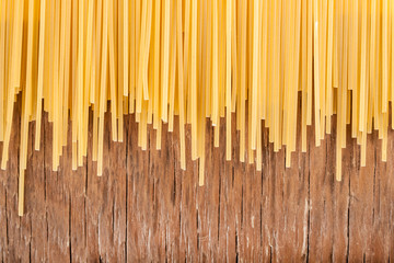 Panel Szklany Podświetlane Do restauracji uncooked spaghetti posted on the a row