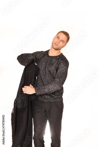 Fotografie, Obraz  Mann zieht Mantel aus